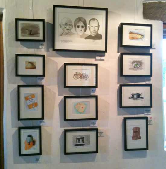 Sketches framed on a wall at an art show