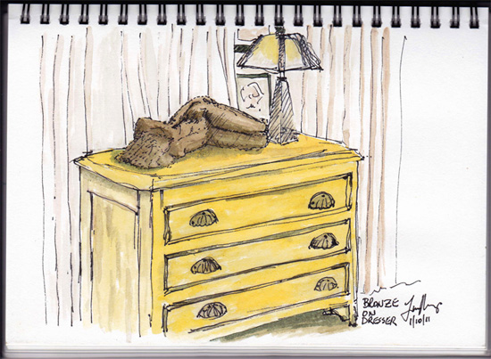 sketch of sculpture on dresser under light